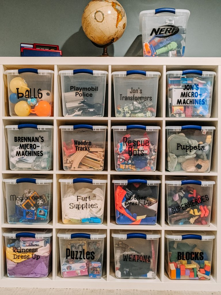 Keeping quality toys and rotating them encourages focused play and more imagination, without letting kids get overwhelmed. After the purge: Cube shelving, clear bins, and labels help identify toys that were worth keeping and make clean up a breeze.