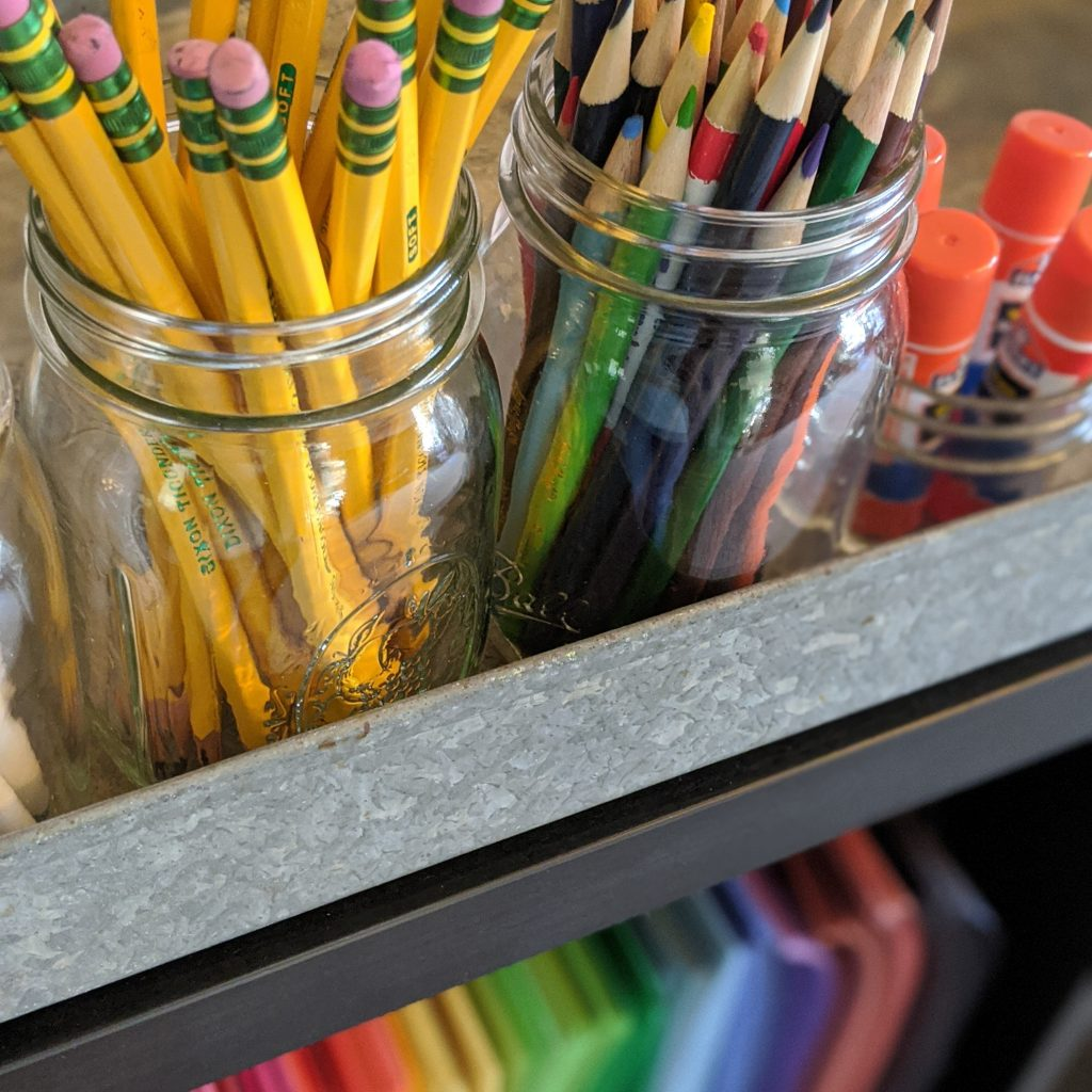 Keep organizing simple. Shop your home for jars to hold writing utensils.