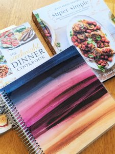 Get ready to start your meal plan by gathering materials like a notebook, calendar, cookbooks, and a list of your favorite meals.