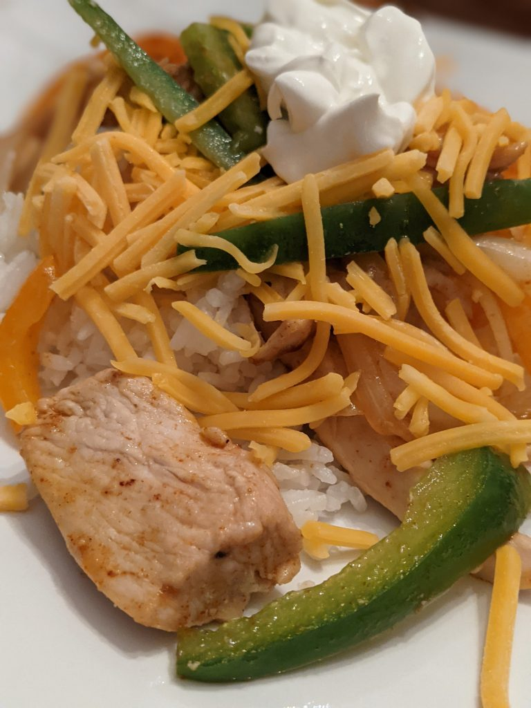 Fajita rice bowls with homemade fajita seasoning are a favorite meal in our family.
