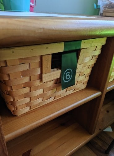 Simple baskets are great for storing paper supplies and coloring books.