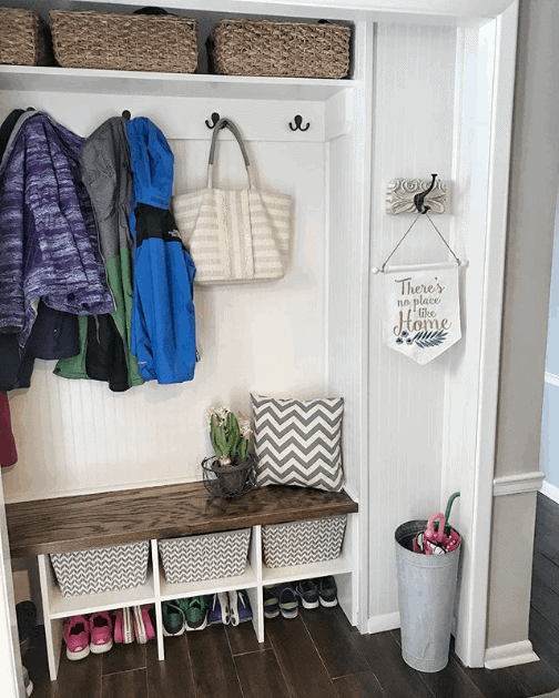 DIY Mudroom Ideas: Remove closet doors and add a bench for a perfect little mudroom nook.
