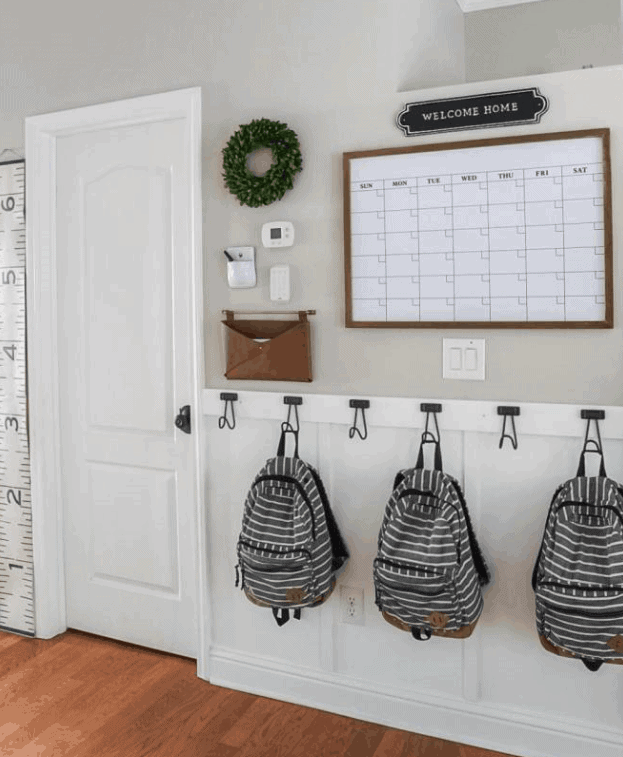 DIY Mudroom Ideas: Board and batten, hooks, and a command center combine style and function.