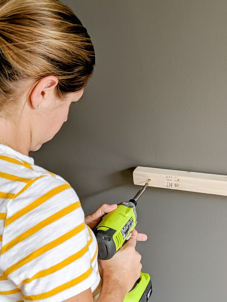 Getting a little power tool practice while installing the ledger board for the homework station.