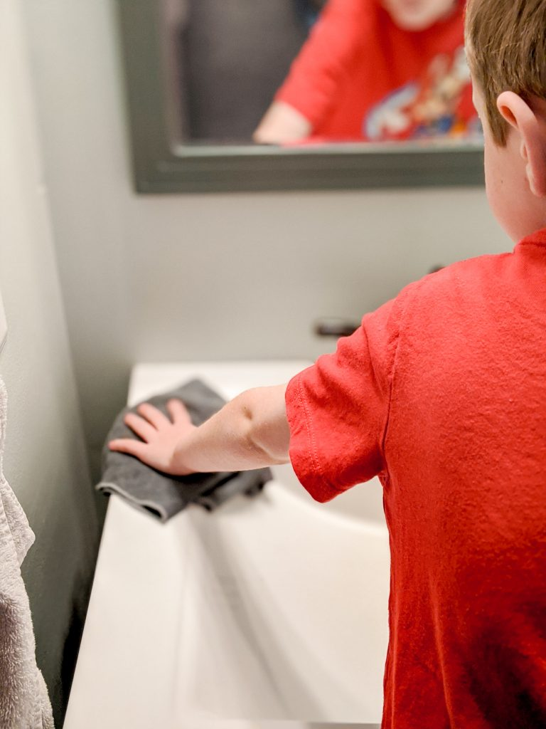 Kids as young as 5 or 6 can wipe down a bathroom sink! A microfiber cloth and water is all you need!