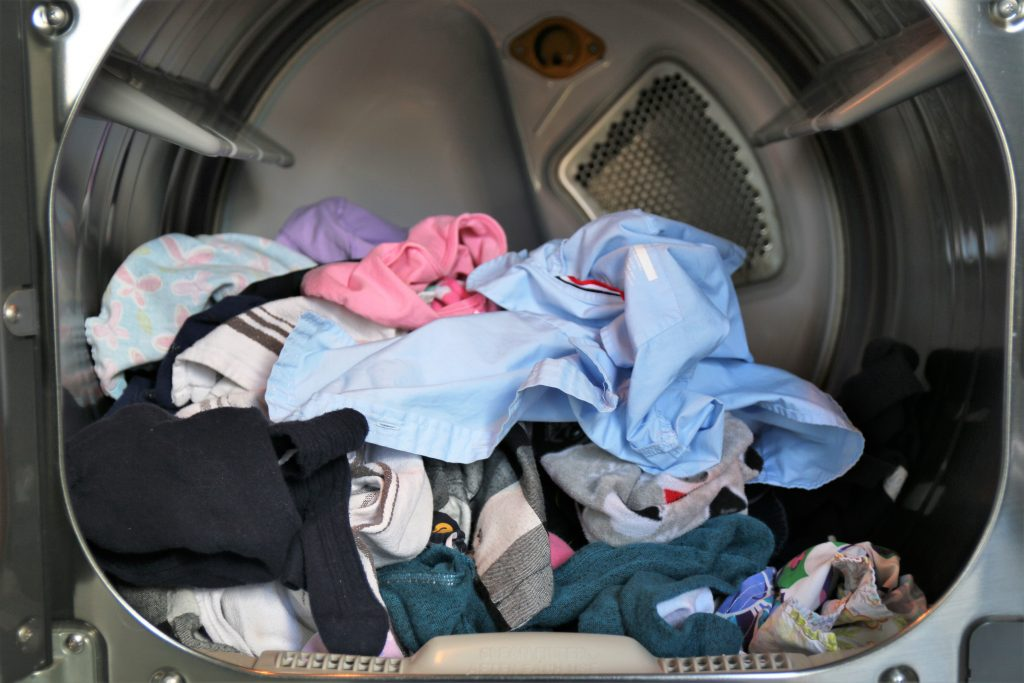 My laundry routine starts with one person's laundry, unsorted, getting washed.