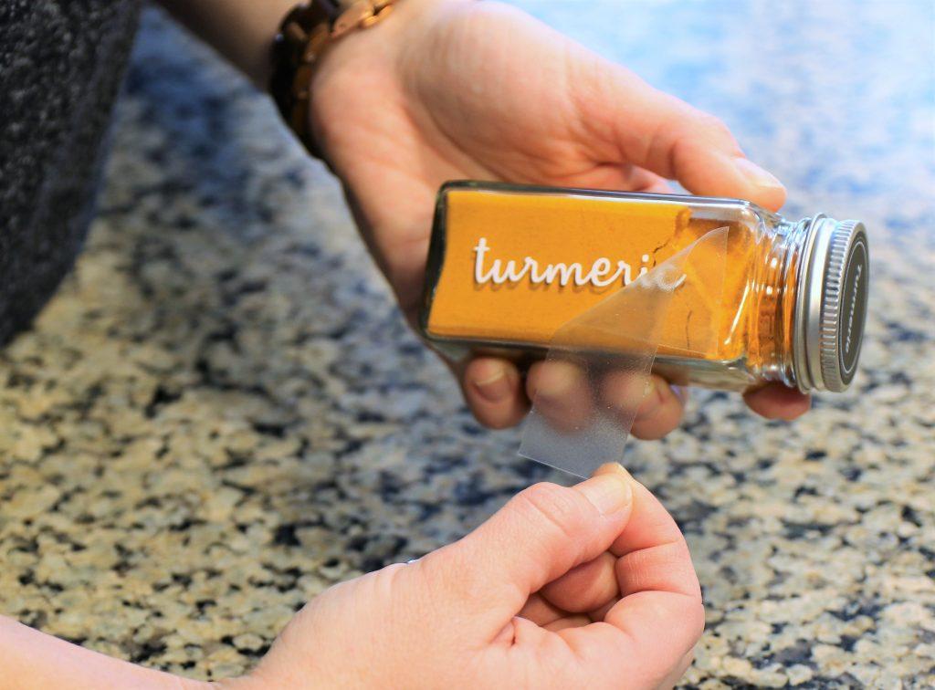 Spice Organization Ideas - Custom vinyl labels applied to glass jars.