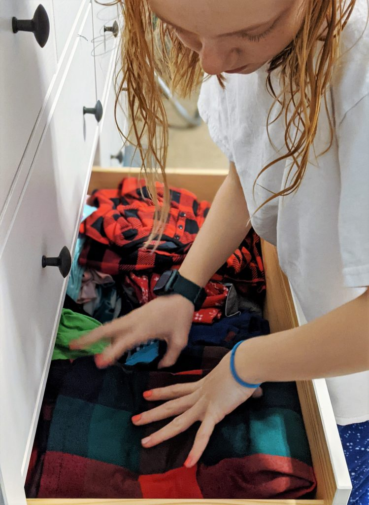 The last step to teaching kids laundry is to have them do a whole load, from start to finish!